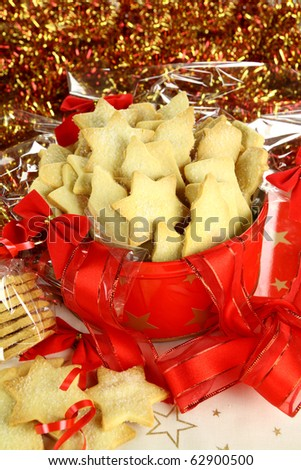 Delicious fresh baked Christmas shortbread wrapped in cellophane and in a Xmas tin. - stock photo