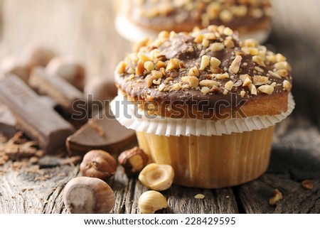 Delicious fresh baked muffins, grated chocolate and portion of chocolate  - stock photo