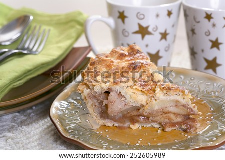 Delicious fresh baked rustic Apple Pie with tale setting - stock photo