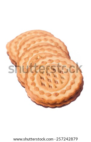Delicious fresh biscuits with chocolate filling on a white background - stock photo