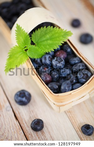 Delicious fresh blueberry in the basket on the table