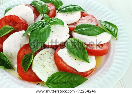 Delicious fresh Caprese Salad on a white dish.