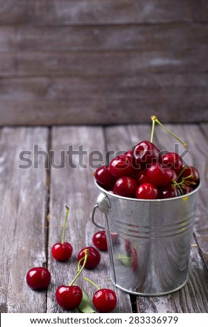 delicious fresh cherries on grey wooden table