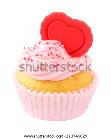 Delicious fresh cupcake decorated with pink buttercream, sugar sprinkles and a red heart isolated on white background