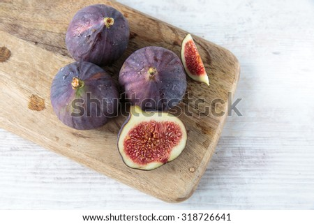 Delicious fresh dark figs on a chopping board