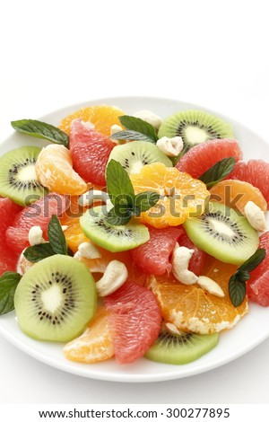 Delicious fresh fruit on plate  - stock photo