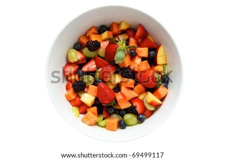 Delicious fresh fruit salad isolated on white background - stock photo