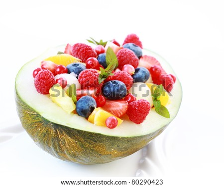 Delicious fresh fruit salad served in melon bowl as dessert
