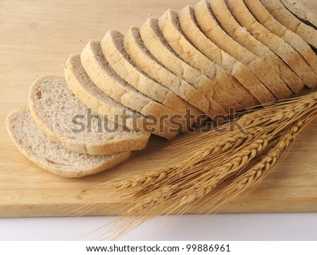 Delicious, fresh, home-made whole wheat and ragi bread. Sliced. Isolated on wood plank - stock photo