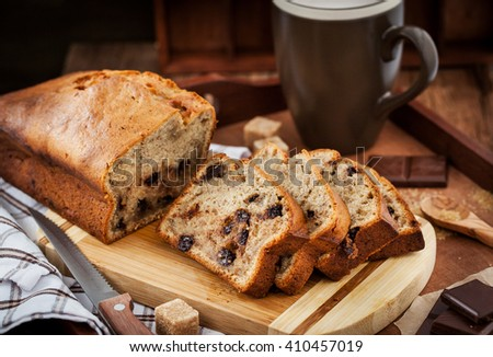 Delicious fresh homemade banana bread (loaf cake) with chocolate for breakfast - stock photo