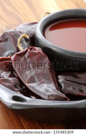 Delicious fresh hot chili sauce, made with red hot peppers. - stock photo