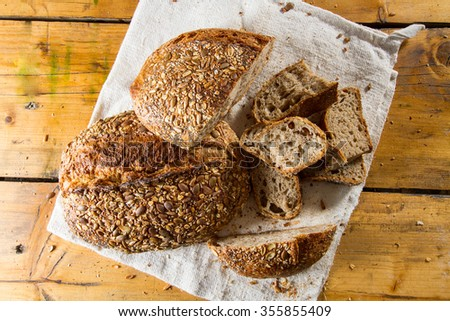 Delicious fresh loaves of multigrain brown bread. - stock photo