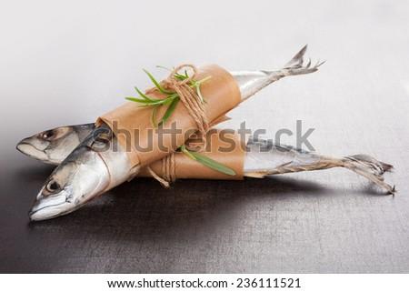Delicious fresh mackerel fish on stone background. - stock photo