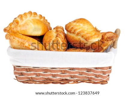 delicious fresh meat pies in  basket - stock photo