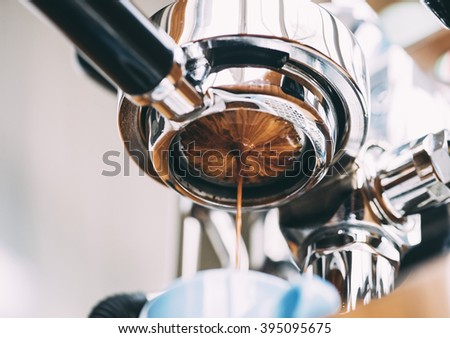 Delicious fresh morning espresso coffee pouring through the bottomless portafilter - stock photo