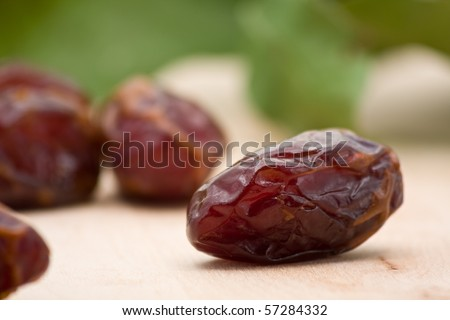 Delicious fresh organic dates on wooden table