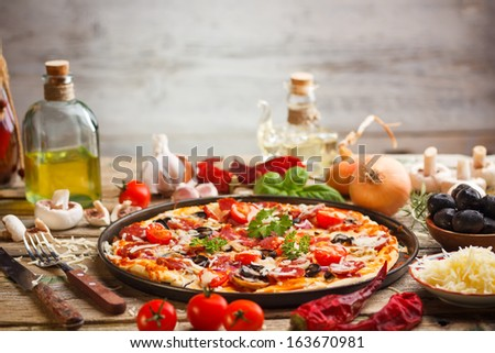 Delicious fresh pizza with ingredients - stock photo