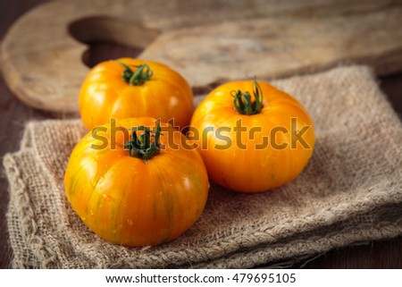 Delicious fresh raw  yellow tomatoes for an healthy nutrition