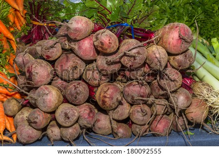 Delicious fresh ripe beetroots at local fruit and vegetables market - stock photo