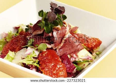 Delicious fresh salad of smoked duck breast, lettuce and chutney - stock photo