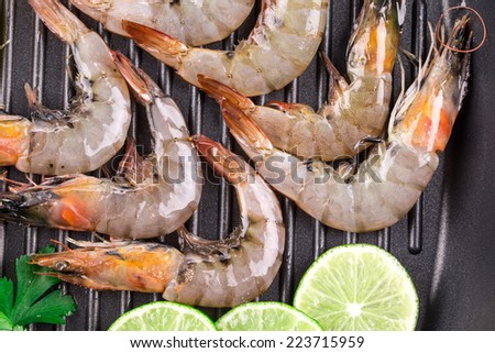 delicious fresh shrimps with lemon in closeup  - stock photo