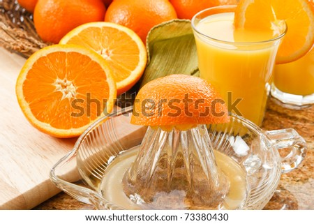 Delicious fresh squeezed orange juice is filled with Vitamin C and Potassium making it a good healthy choice for a natural beverage with breakfast. - stock photo
