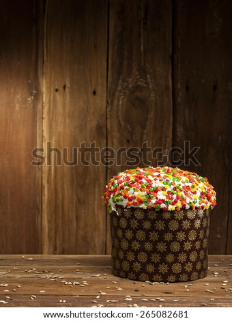 Delicious freshly baked Easter cake on a wooden background - stock photo
