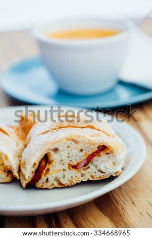 Delicious freshly baked white bread with chorizo inside - stock photo