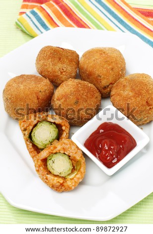 Delicious fried brussel sprouts with ketchup - stock photo