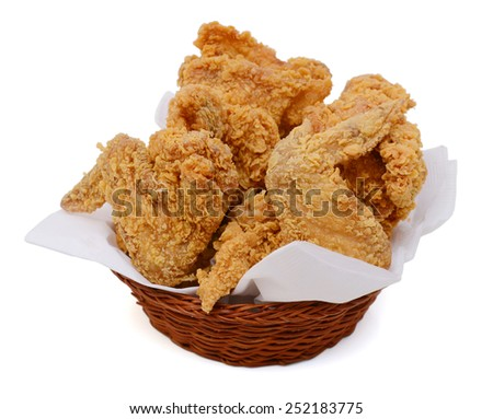 delicious fried chicken wings in basket isolated on white - stock photo