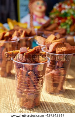 Delicious fried croutons in a cup closeup
