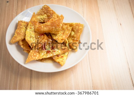 Delicious Fried dumpling crispy on the wood table - stock photo