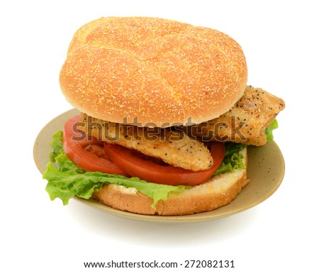 delicious fried fish sandwich on plate isolated on white  - stock photo