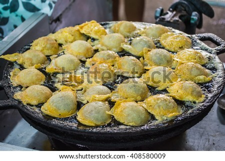 Delicious fried mussel in batter. Good Thai food. - stock photo