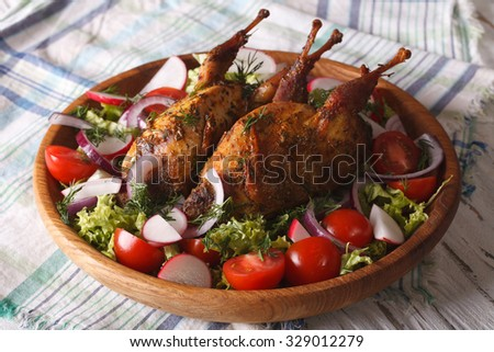 delicious fried quail and fresh vegetables close-up on a plate. horizontal - stock photo