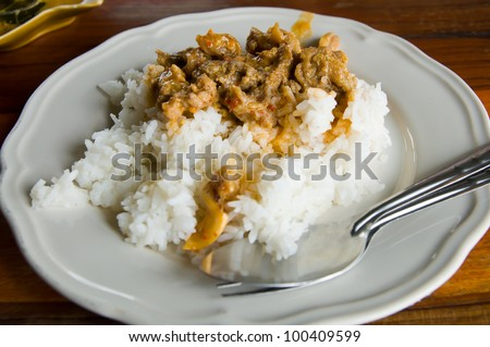Delicious fried rice and meat close-up on white - stock photo