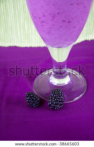 Delicious frozen smoothie with  strawberry, mint and blackberry - stock photo