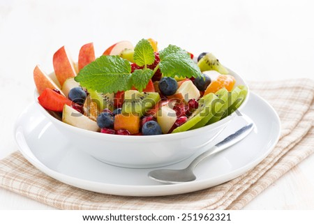 delicious fruit and berry salad, close-up - stock photo