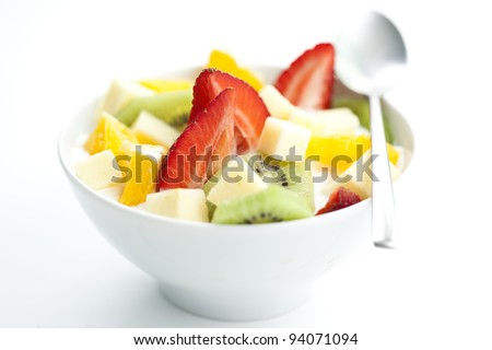 delicious fruit salad with chunks of fruit and yogurt - stock photo
