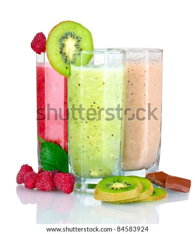 Delicious fruit smoothies and fruits isolated on white