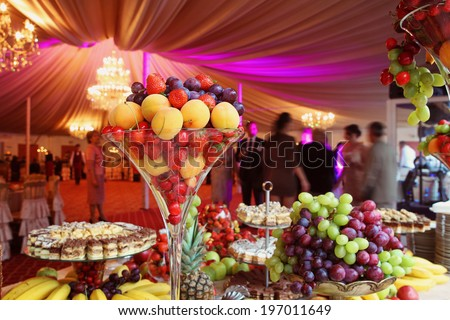 Delicious fruits on glass vase - stock photo