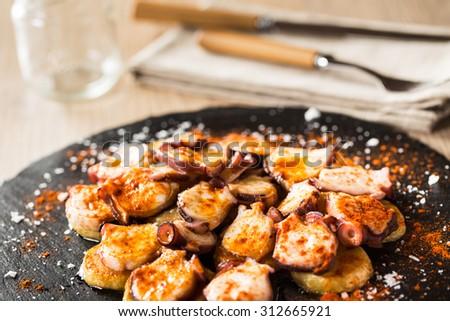 Delicious galician octopus: Pulpo a Feira. Typical spanish tapas. - stock photo