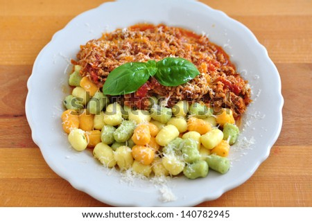 Delicious gnocchi with bolognese sauce - stock photo