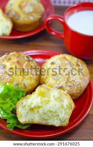 Delicious golden colored corn bread with sesame  served with yogurt and green salad in  a red plate - stock photo