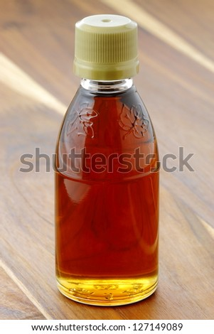 delicious grade A medium amber maple syrup, with a pronounced maple bouquet. - stock photo