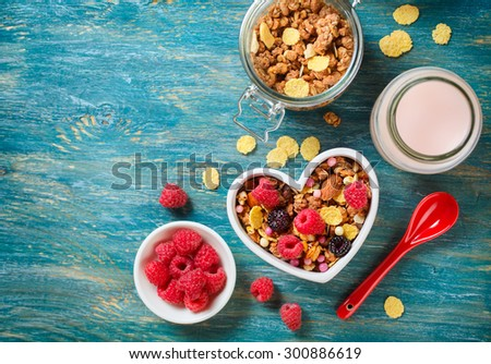 Delicious granola with berries. Healthy breakfast. View from above - stock photo