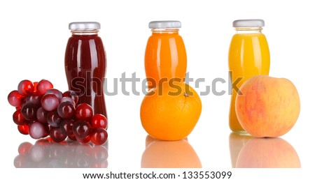 Delicious grapes, orange and apple juice in glass bottle and fruit next to it isolated on white - stock photo