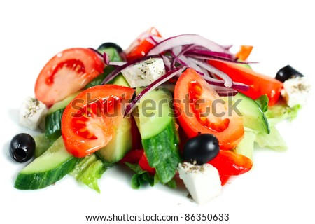Delicious Greek salad. Bright, tasty and healthy. Isolated on white