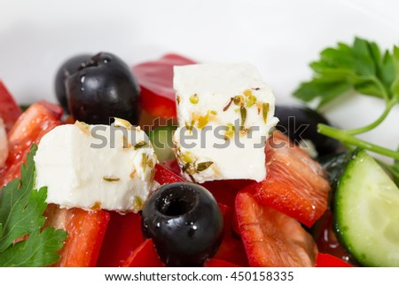Delicious greek salad with olives and paprika. Macro. Photo can be used as a whole background. - stock photo