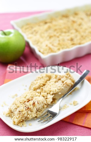 Delicious green apple crumble served on white plate
